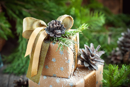 Christmas Natural Decor on Vintage Boxes, pine cones, ribbons and fir tree