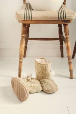 warm house: Warm House Slippers in front of wooden chair, toned