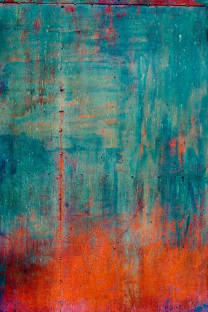 ひびの入った塗料で錆びた色金属グランジ背景、青とオレンジ 写真素材