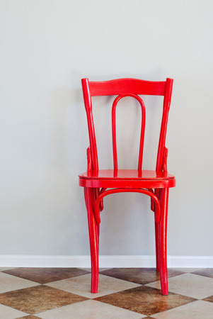 Red Chair on Tiled Floor and Near Grey Wall, indoor