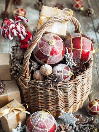 Vintage Christmas Gifts in Magic Composition with Basket.  photo