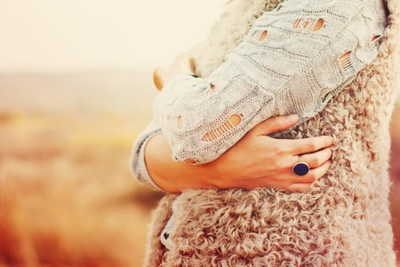 The Woman Embraces Herself Hands, Ring in the finger, outdoor