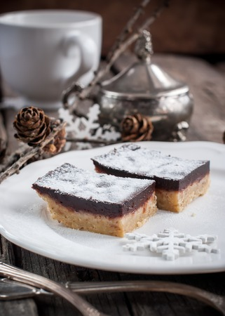 Chocolate Brownies with Shortcake Dough on a White Plate, sweet dessert photo