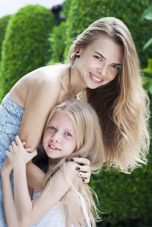 Beauty mother and daughter. Happy relationship. Hugging Stock Photo