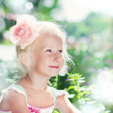 beautiful sunshine: Beautiful Girl with in Pink Rose Playing in the Summer Garden, in Rays of Light