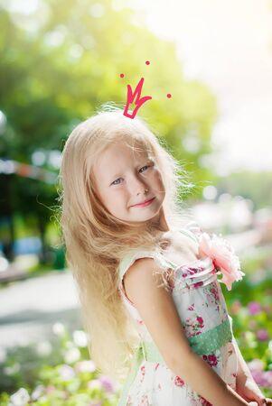 little girls: Adorable Little Girl Posing as Princess with Drawn Crown in Morning Park Stock Photo