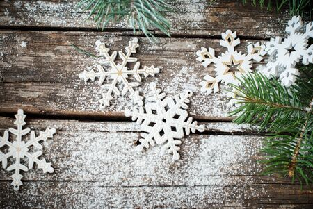 craked: Christmas Decotative Decor White Snowflakes with Fir tree on Craked Wooden Table
