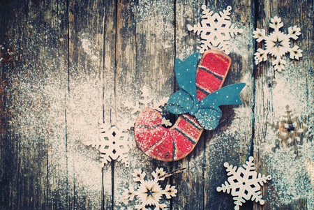 Vintage Christmas Fir Tree Toys Candy Cane and Snowflakes on Wooden Background. Horizontal image. Toned