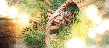 stick of cinnamon: Christmas Bright Light with Natural Gifts, Pine Cones, Branches of Blue Fir Tree, Stick Cinnamon from Rural Basket. Top view