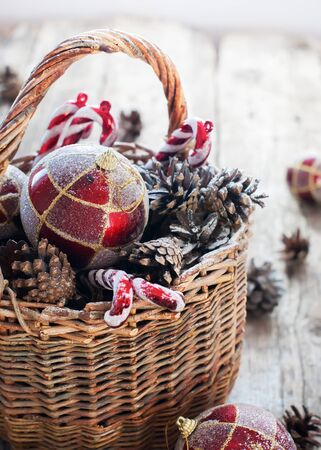 cristmas card: Christmas Vintage Gifts in Basket, Red Gold balls, Pine cones, Sweet Candy toys