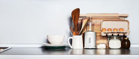 Kitchen Still life as background for Design. Rustic Dishes, Table ware, Fresh Grocery and other Different Stuff on Grey Table-top. Image with copy space Stok Fotoğraf