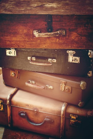 of yesteryear: Old Antique Vintage Trunks in a Stack, Toned image as background