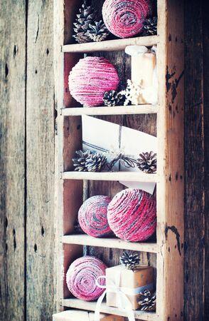 cristmas card: Vintage Christmas Gifts on Retro Shelf, wooden background. Drawn Snowfall