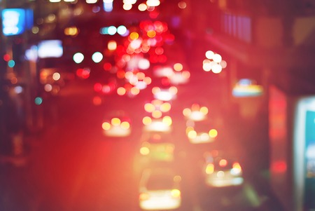 of movement: Traffic Movement in the Night City. Blurred Defocused Multi Color Lights. Toned in Vivid Colors. Abstract Background Stock Photo