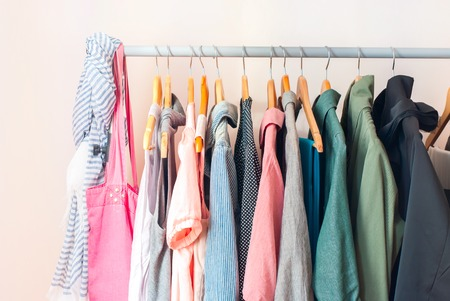 clothes rail: Pastel Color Female Clothes in a Row on Clothes Rail