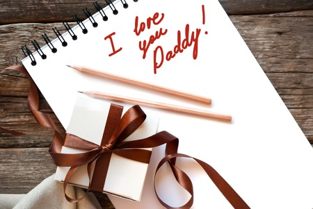 happy valentines day: Festive Box Brown Ribbon Congratulation with Fathers Day on Wooden Background. Light Toned Effect. Men Present. Gift Concept Stock Photo