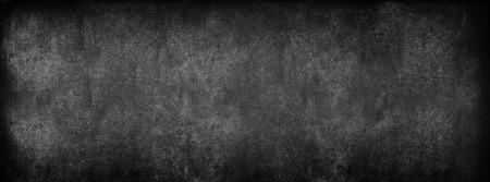 Black Classroom Blackboard Background. Chalk Erased School Chalkboard Vintage Texture. Long format Foto de archivo