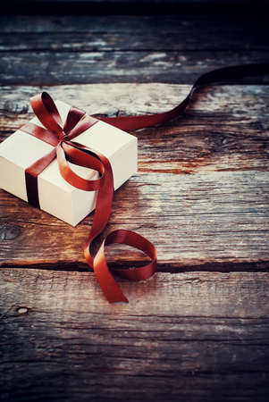 happy valentines day: Festive Box Brown Ribbon on Wooden Background. Light Toned Effect. Men Style