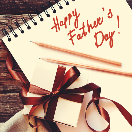 happy valentines day: Congratulation on Paper with Fathers Day Festive Box Brown Ribbon Wooden Background. Light Toned Effect. Men Present. Gift Concept