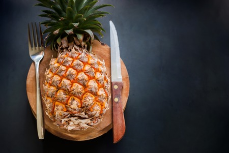 veiw: Fruit Fresh Pineapple on Black Background Fork Knife Chopping Board Diet Concept Top Veiw