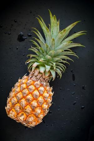 top veiw: Whole Pineapple Fruit Drops Black Background Diet Concept Top Veiw Stock Photo