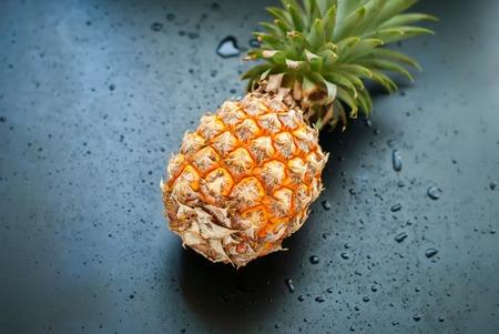 top veiw: Whole Pineapple Fruit Drops Dark Background Diet Concept Top Veiw
