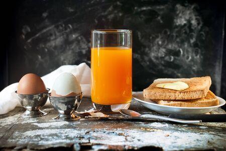 kinfolk: Row Boiled Eggs Orange Juice Toasts Spoon Rustic Black Shabby Table Breakfast Concept Selective Focus