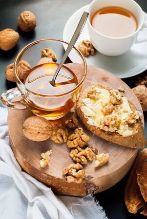 Stil: Useful Breakfast Toast with Honey Walnuts on Chopping Board to Tea Stil Life Table Healthy Food Stock Photo