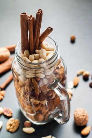 hazel nut: Glass Jar Assortment Nut Peanut Almond Cashew Walnut Filbert Hazel Nut Pecan Black Wooden Background Top view Healthy Concept