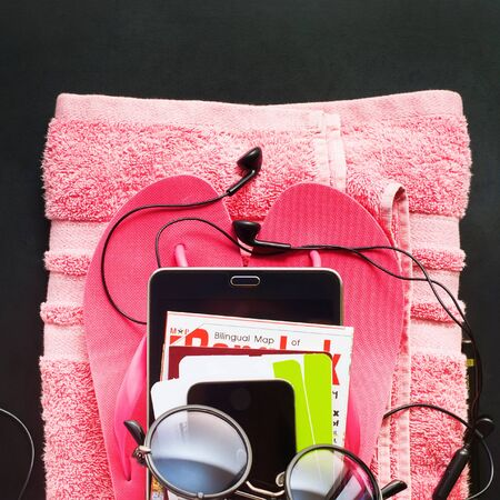 fun in the sun: Female Clothes Accessories Gadgets Earphones Pink Towel Stack Gather Trip Travel Modern Concept
