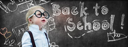 Portrait Cute Little Boy with Glasses Child Prodigy Dark Chalking Board Text Sign Concept Back to School Black Background