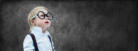 prodigy: Portrait Cute Little Boy with Glasses Child Prodigy Dark Chalking Board Empty Copy Space Concept Back to School Black Background