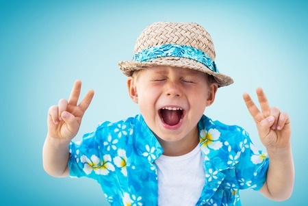 hawaiian shirt: Child Shouts Laughs Hawaiian Shirt Straw Hat Holidays Clothes Isolated Blue Background Stock Photo