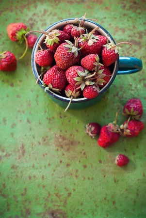 rustic food: Strawberry Garden Rustic Cup Summer Food Metal Background Selective Focus Stock Photo