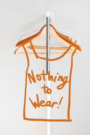 Nothing To Wear Design Concept Empty Wooden Coat Hanger Open Cloth Rail Grey Wall