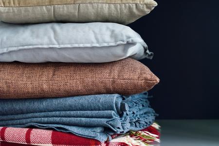 throw cushion: Colorful Pillows Cushion Plaid Stack on Dark Background