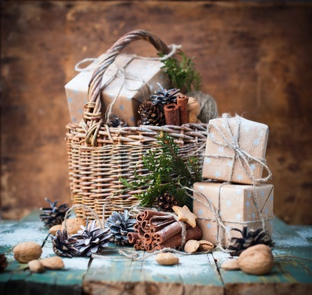 pinecones: Christmas Card Gift with Box Basket Pine Cone Walnut Almond Cinnamon on Wooden Background