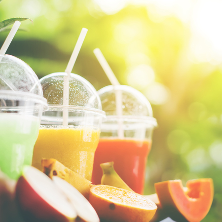 Party Time Fresh Smoothie Juice and Different Fruits Summer Outdoor Background Selective Focus