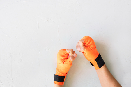 Female Fists in Bandage for Thai Boxing on Grey Background