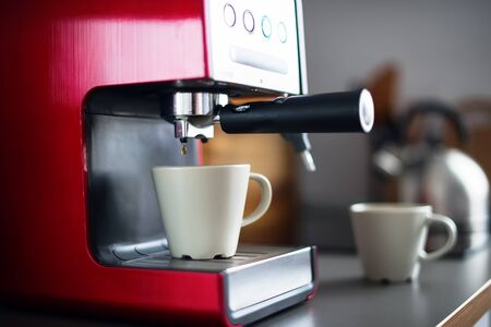 Close-up of Coffee Espresso Pouring from Machine Home Made Cooking