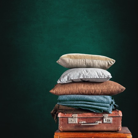 Vintage Ancient Suitcase Pillow Plaid Stack Tower Design Concept Shabby Dark Background Long Format Stock Photo