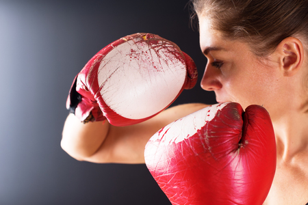 Close up Power Woman Old Red Boxing Gloves Fighter on Dark Background Stock Photo