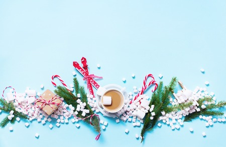 Christmas Gift Mini Marshmallows Candy Cane Cocoa Poweder Sugar Blue Background Copy Space Flat Lay Top View Winter Traditional Food Drink