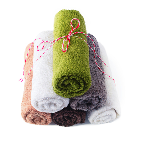 stack roll bath towels pyramid celebration ribbon colorful cotton textile objects isolated on white