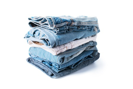 stacked monochrome jeans denim cloth gray blue linen textile isolated on white pile concept Stock Photo - 88391368