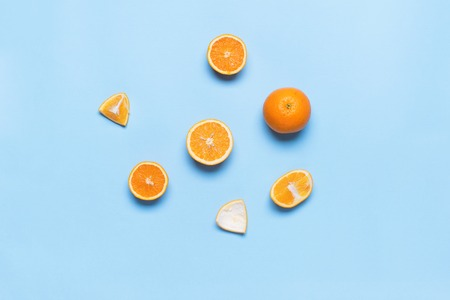 Colorful Food Cut Whole Juice Orange Fruit Hands Holds Blue Background Top View Flat Lay