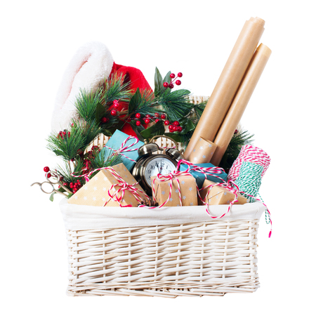 Packing Christmas Gifts Vintage Beige Blue Wrapping Paper Decor Boxes Wreath Holly Berry Santa's Hat in White Basket Isolated on White