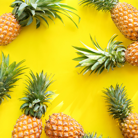Pine Apple Whole Tropical Fruits with Leaves Yellow Background Useful Natural Organic Food Style Top View Flat Lay Group Objects