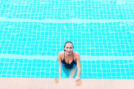 Beautiful Young Suntanned Woman Blonde Long Hair Bathing Suit Black Swimming Pool Resort Suntan Skin Holiday Vacation Outdoor