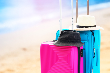 Blue and Pink Trunks Two Suitcases Luggage Travel Things Accessories Clothes Summer Caps Concept Summer Holiday Adventure Preparation Trip Isolated on Sea Coast Blurred Background